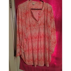 Light weight , salmon? Pink top with sleeves.